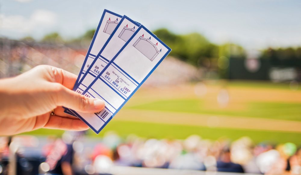 USA, Maine, Portland, Close-up of hand holding tickets at stadium